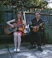 Picture of Annabel and John playing guitar